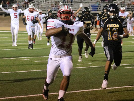 Valencia's Jorge Lopez sprints into the end zone for
