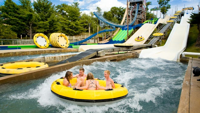Rafters shoot down a water slide at Noah's Ark water park in Wisconsin Dells, one of the attractions to which Kewaunee County is offering discount tickets this summer to its residents.