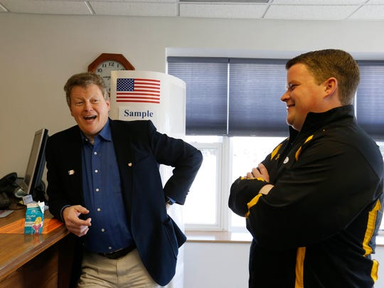 Pat Murphy, Democratic candidate for Iowa's 1st Congressional District, left, and his son, John, wait for Teri Murphy to finish voting Thursday, May 5, 2016, at the election annex building in downtown Dubuque.