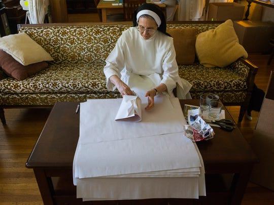 Sister Emmanuella Handlos packs up the belongings of the nuns at Caterina Benincasa Dominican Monastery at Holy Spirit Church.