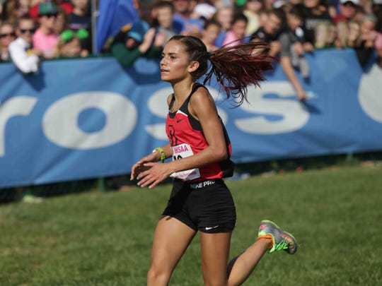 Girls 2016 individual Cross Country Champion, Tyler Schwartz, from DeKalb, crosses the finish line during the IHSAA cross-country state finals, held in Terre Haute IN, at LaVern Gibson Championship Cross Country Course and Wabash Valley Sports Center, Saturday october 29th, 2016.