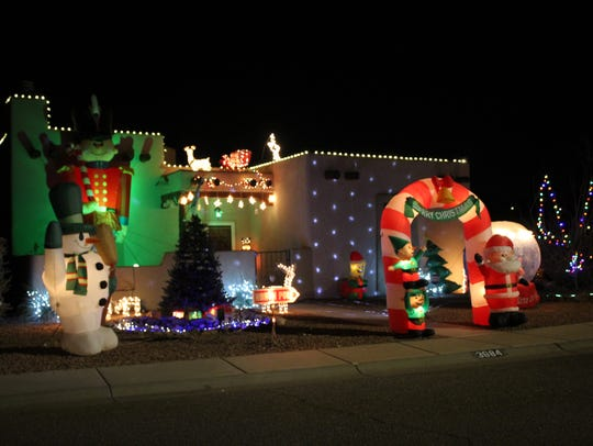 Inflatable characters take center stage at this house located at 3984 Tiger Woods Drive.