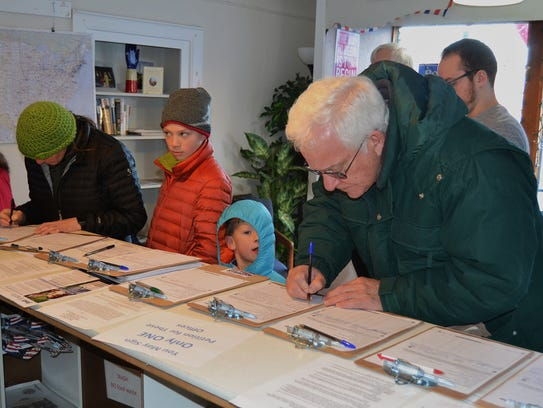 Signing petitions is a family affair at ACDC Headquarters.