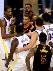 Cleveland Cavaliers center Tristan Thompson, top, yells