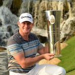 Jamie Donaldson of Wales poses with the winner's trophy