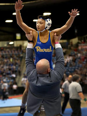 Jacob Tangpricha captured the Class 6A state championship at 106 pounds last year and is ranked No. 1 at 113 pounds this season. He's one of 11 Junior Blues who qualified for Saturday's state tournament as No. 1 Rural looks to capture the program's first team state championship.