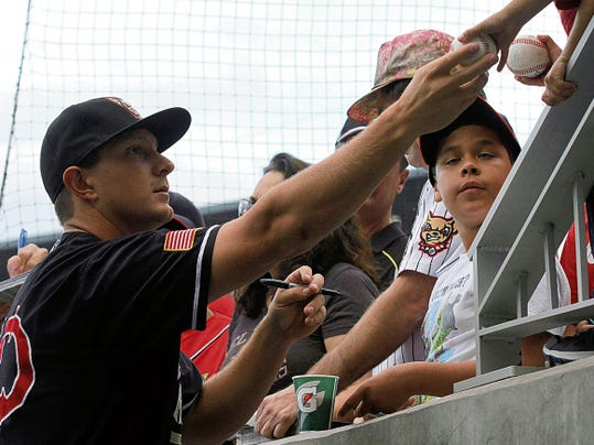 RUBEN R RAMIREZ—EL PASO TIMES Alex Dickerson signed autographs for fans before the start of Saturday nights  game against the Tacoma Rainiers.