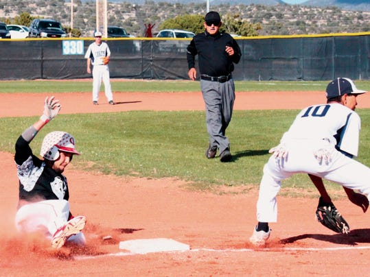 Danny Udero/Sun-News   Cobre's Hondo Tovar slides safely into third base during action against Silver at the Ben Altamirano Sports Complex on Tuesday.