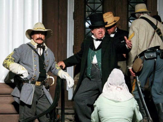 Confederate soldiers prepare to burn the Franklin County Courthouse during last year's reenactment of the Burning of Chambersburg.