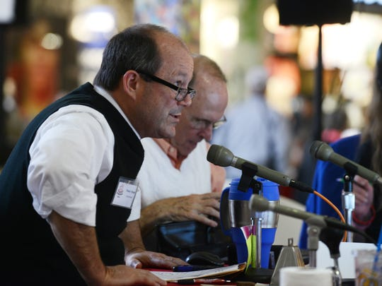 Stoey Stout talks during the radio broadcast of the Carr Center Cake Auction on Friday.