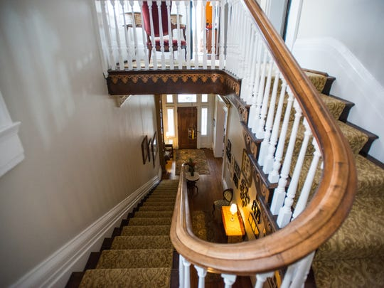 The original banister wraps around from the second floor to the first floor inside the Desmarais' 1854 Covington home. The house was once the Amos Shinkle Townhouse Bed and Breakfast in Covington.