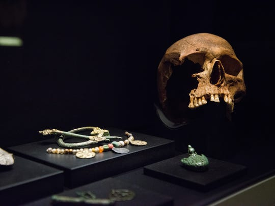 "A brooch and necklace sit on display next to a skull to show what a Viking might have worn in the Cincinnati Museum Center for the ""Vikings: Beyond the Legend"" exhibit, which will open November 11, 2016."