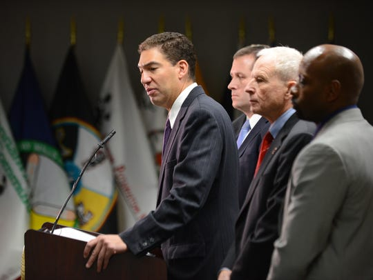 United States Attorney Patrick Miles speaks to the