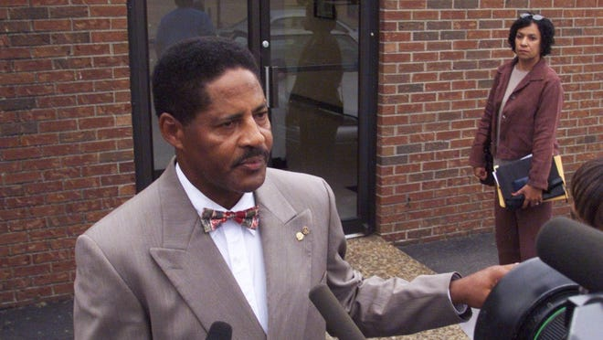Ludye Wallace, president of the local NAACP chapter, talks with media prior to a membership meeting.  5/25/1999