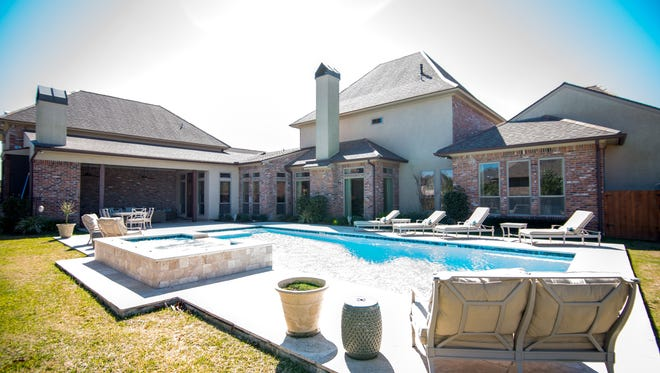 Sparkling pool and outdoor area offer loads of entertainment space.