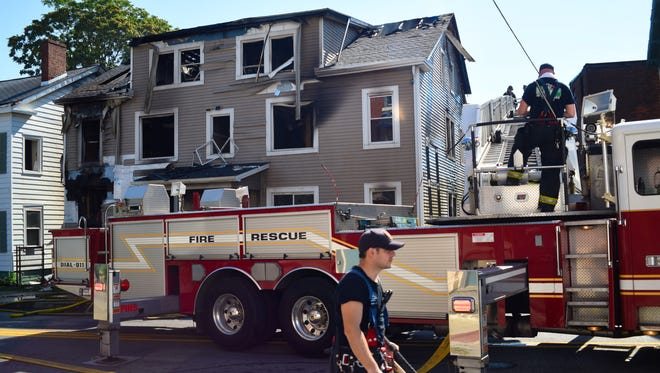 City of Poughkeepsie Firefighters respond to a fire at 7 North Hamilton St. in the city Sunday morning.