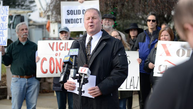 Local activist Bill Brennan announces his bid for governor in front of Wayne Municipal Hall on Monday during an anti-Christie rally.