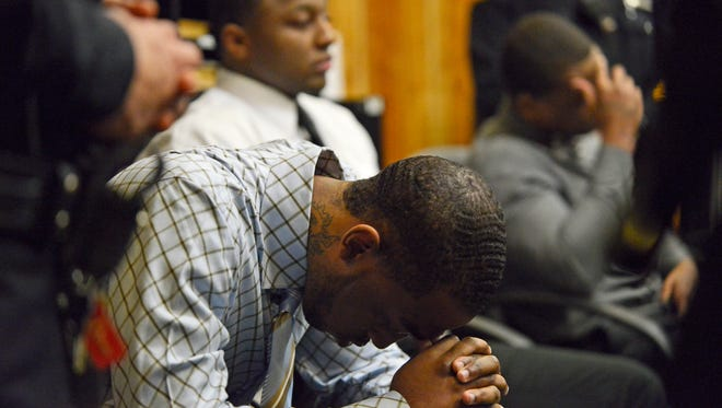 Defendant Jahmad Green bows his head before the jury delivers its guilty verdict on Tuesday.