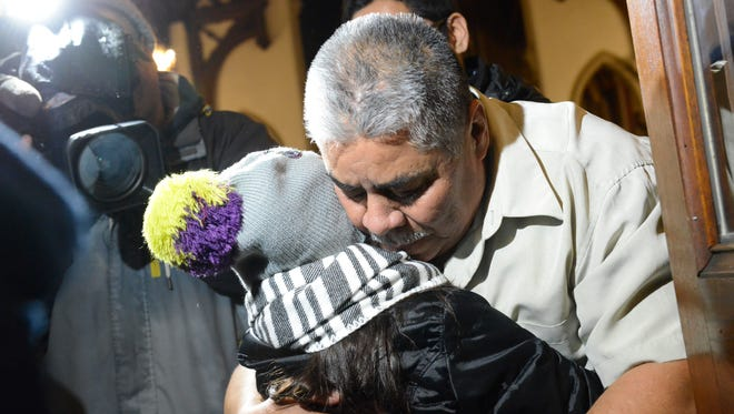 Catalino Guerrero of Union City hugs his granddaughter, Elizabeth Perez, 7, at Grace Episcopal Church on March 10, 2017. Guerrero, facing deportation, was given a stay until May when he will have to report to the U.S. Immigration and Customs Enforcement again.