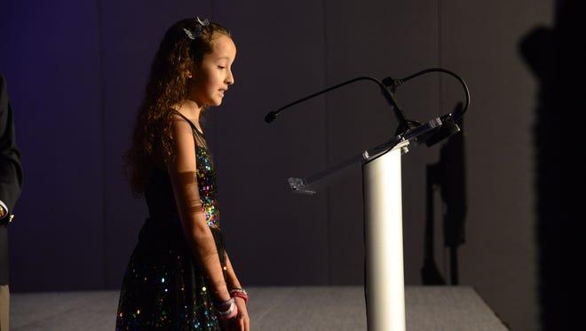 Sabine Rivera, a fifth grade student at Lely Elementary, reads her essay at the Barbara Bush Foundation's Celebration of Reading kick-off breakfast Friday, Feb. 16 at the Hyatt Regency Coconut Point Resort & Spa.