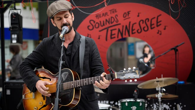 Singer-songwriter Gill Landry performs at opening of Tennessee Tourism exhibit at London's Waterloo Station.