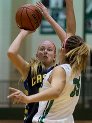 Castle's Chloe Mills (32) shoots as North's Maddie