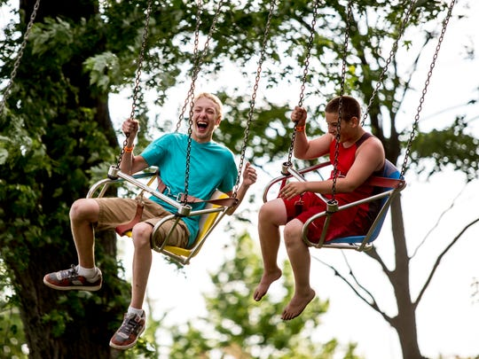 Jacob Richmond, 14, of Marysville, and Eric Compton 13, of Port Huron, laugh together on the YoYo ride during the Marysville Days carnival Wednesday, June 22, 2016 at Marysville City Park. The carnival continues through Sunday.