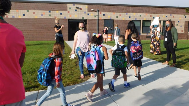 Children are greeted and applauded as they arrive Thursday, Sept. 3, 2020, for opening day at Herkimer Elementary School.