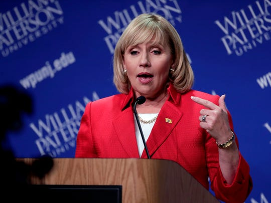 Republican nominee Lt. Gov. Kim Guadagno talks to reporters after participating in a gubernatorial debate against Democratic nominee Phil Murphy at William Paterson University, Wednesday, Oct. 18, 2017, in Wayne.