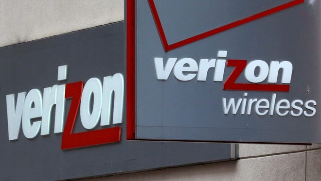 This June 4, 2014 photo shows signage at a Verizon Wireless retail store at Downtown Crossing in Boston.