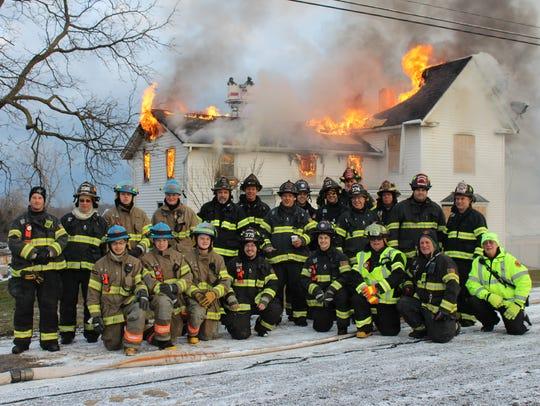Members of the Webster Volunteer Fire Department pause
