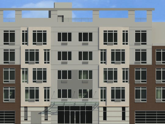 A rendering of a five-story, 60-unit apartment complex