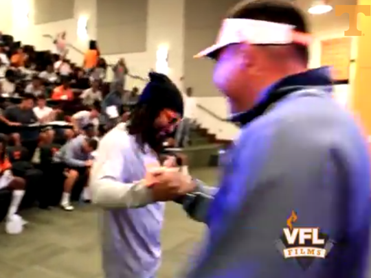 Rapper Lil Jon and Butch Jones shake hands upon meeting