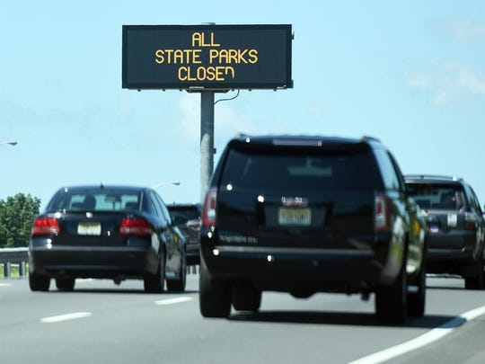 A sign on Rt. 80 West near mile marker 32 warns motorists that all New Jersey state parks are closed on July 2. The parks were closed because of a government shutdown after the Legislature failed to pass a budget.