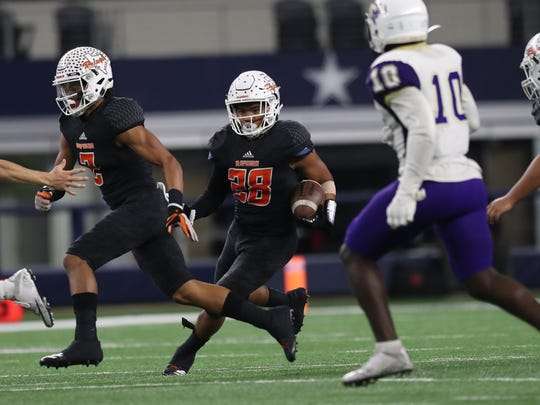 Refugio's Daryon Ramirez rushes the ball against Mart during the Class 2A Division I state championship game Wednesday, Dec. 220, 2017, at the AT&T Stadium in Arlington.