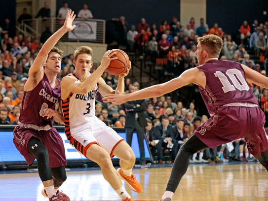 Bucknell's Jimmy Sotos (3) drives to the basket between
