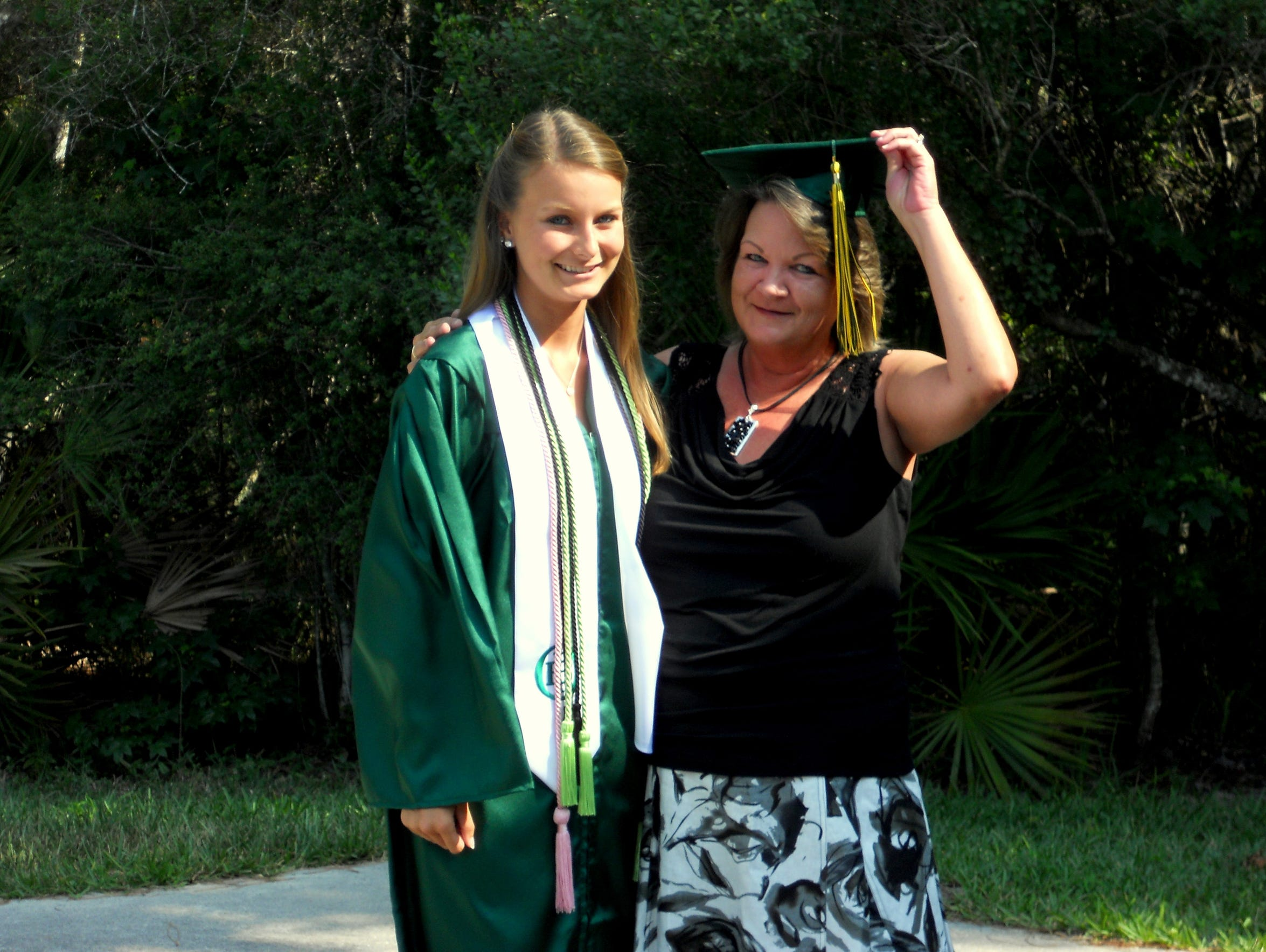 My mom and I at my high school graduation. She never