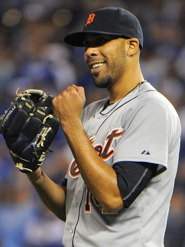 Detroit Tigers starting pitcher David Price (14) celebrates