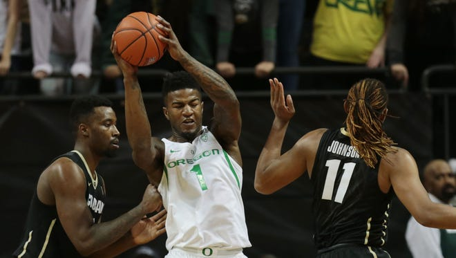 Feb 18, 2017; Eugene, OR, USA; Colorado Buffaloes guard Xavier Johnson (11) and Oregon Ducks forward Jordan Bell (1) fight for the ball in the first half at Matthew Knight Arena. Mandatory Credit: Scott Olmos-USA TODAY Sports