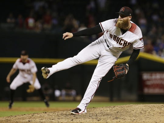 Archie Bradley pitches against the Dodgers at Chase