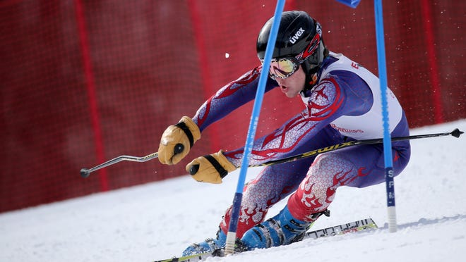 McQuaid's Declan Kelly negotiates a gate during the giant slalom during the Section V alpine skiing championships on Tuesday at Bristol Mountain. Kelly placed third in the event and won the slalom for the runner-up Knights.