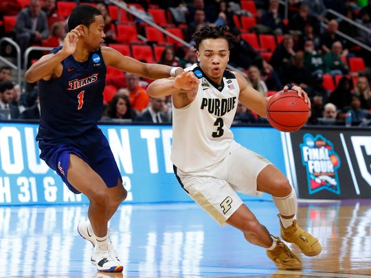 Purdue guard Carsen Edwards (3) drives on Cal State Fullerton guard Jamal Smith (1) during the second half of an NCAA men's college basketball tournament first-round game in Detroit, Friday, March 16, 2018. (AP Photo/Paul Sancya)