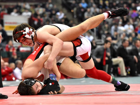 Lucas Byrd of La Salle drives his opponent from Elyria