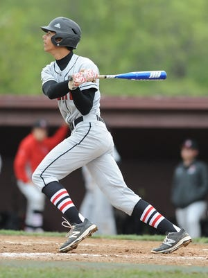 Broncho junior Chandler Ferguson watches as his deep hit to center drives in three runners Monday night.