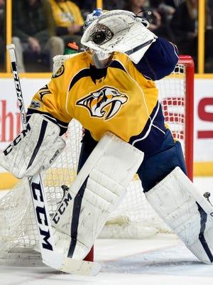 Nashville Predators goalie Juuse Saros (74) stops a Boston Bruins shot during the second period, at Bridgestone Arena in Nashville, Tenn., Thursday, Jan. 12, 2017.