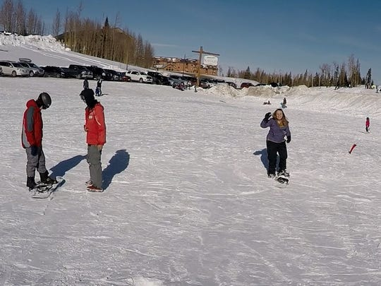 News reporter Emily Havens takes beginning snowboarding lessons for the first time at Brian Head Resort.