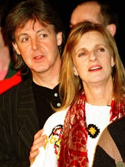 In this file photo, Paul McCartney and his wife Linda give a news conference in New York to announce dates for a world tour on Feb. 12, 1993. Linda McCartney died from cancer in 1998. She was 56.