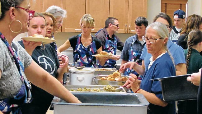 In this November 2014 file photo Our Savior Lutheran Church volunteers served up Thanksgiving dinner for the community.
