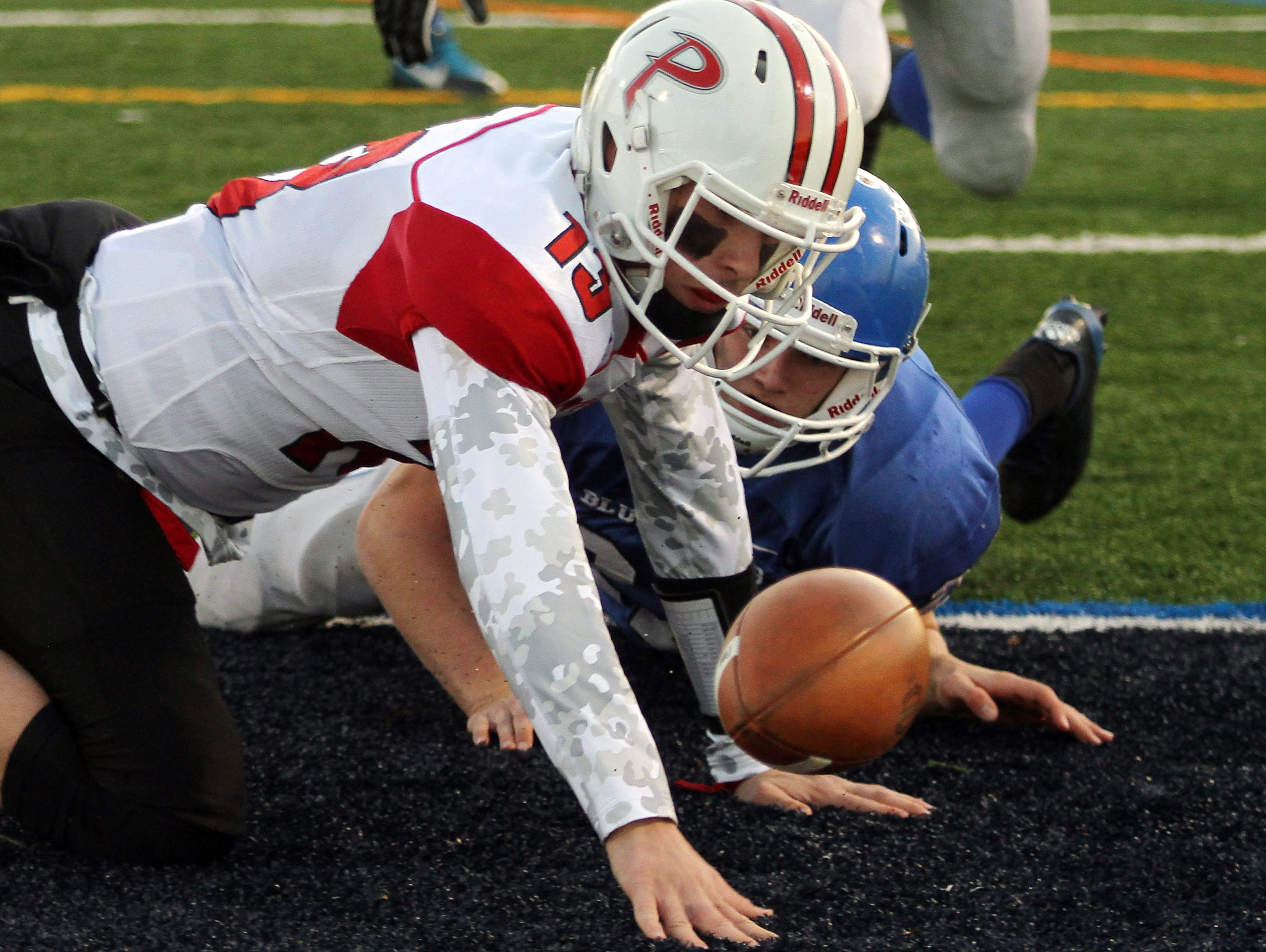 Palmyra quarterback Max Smyth and Shore Regional's Alex Johnson reach for the ball in the end zone after a Smyth fumble. The ball was recovered by Shore for a first half touchdown during the NJSIAA Central, Group 1 Championship game at Kean University Alumni Stadium. December 5, 2015, Union, NJ.