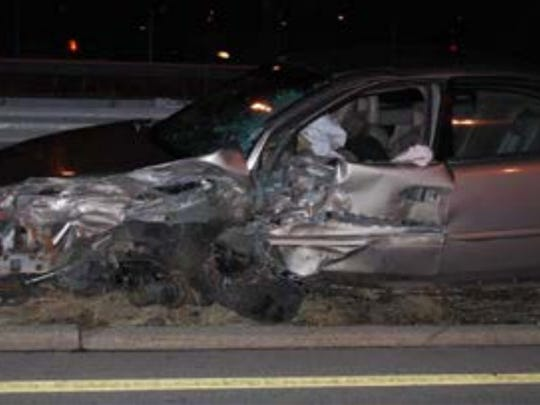 The vehicle of a wrong-way driver is shown after it struck another vehicle on Interstate 43.